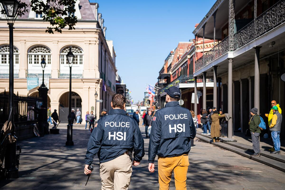 HSI Agents walking down the street