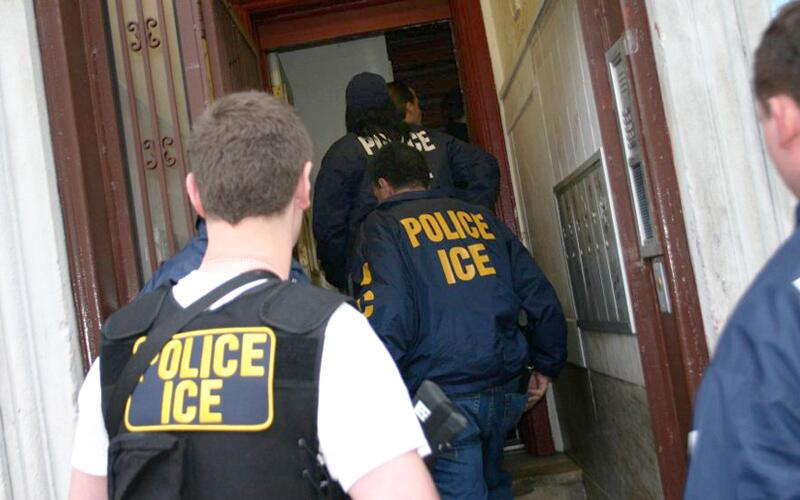 ICE officials conduct an operation.