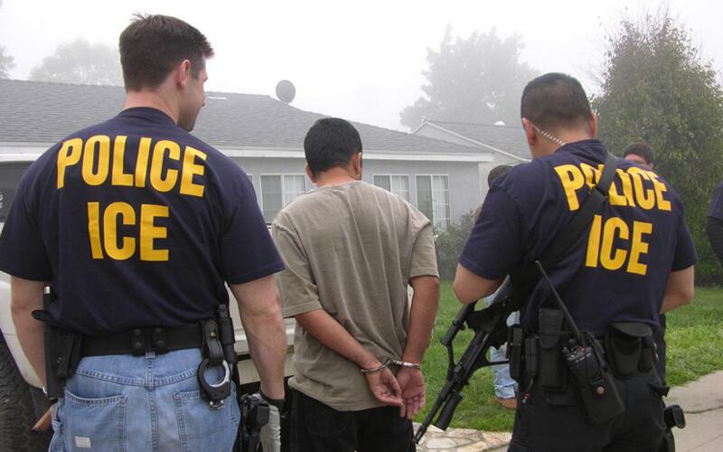 Officials from ICE arrest a person during Operation Community Shield Sept. 13, 2005.