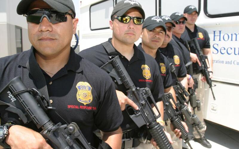Special Response Team members from ICE stand ready May 17, 2005.