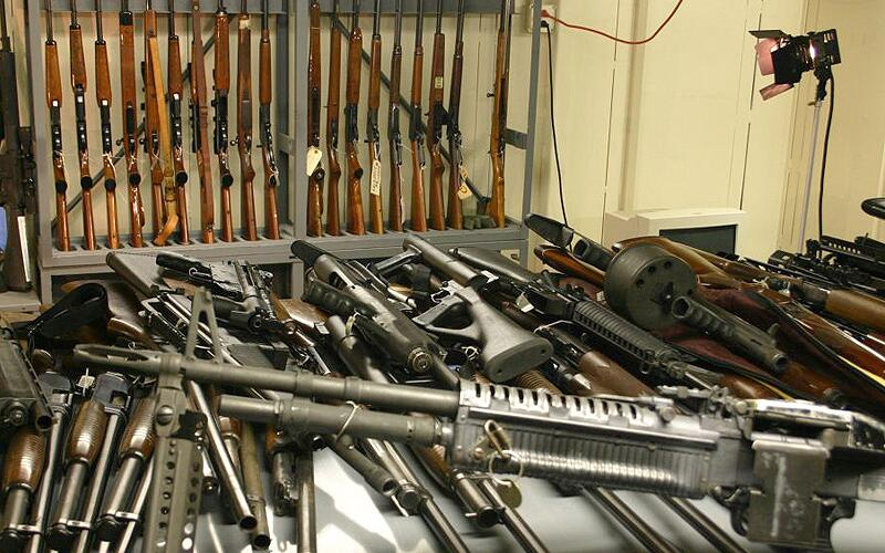 Weapons confiscated by ICE officials are displayed in an agency weapons locker.