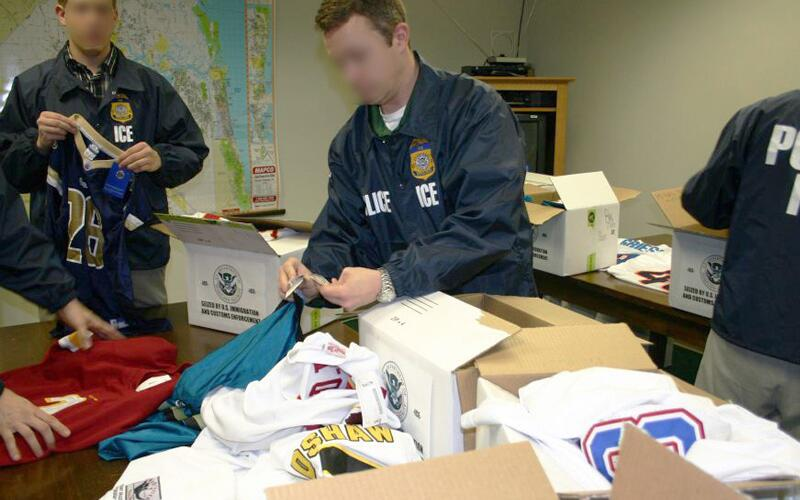 Agents from ICE catalogue confiscated counterfeit merchandise.