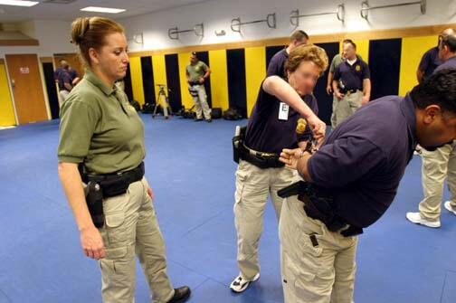 ICE officials practice techniques.