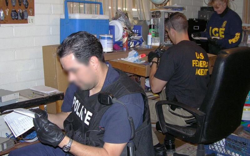 ICE agents conduct an investigation Nov. 14, 2005.