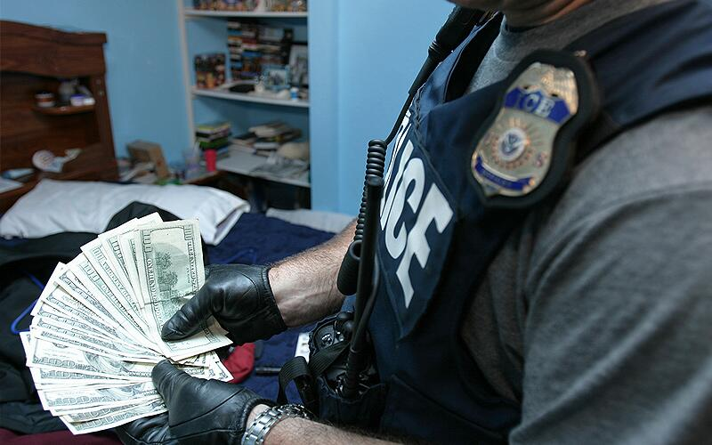 ICE special agents display seized U.S. currency.