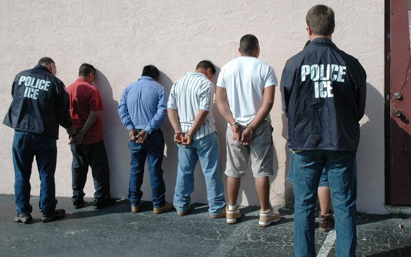 ICE officials conduct multiple arrests during an operation.