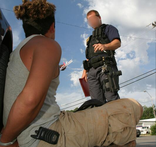 ICE officers arrest a suspect during an operation.