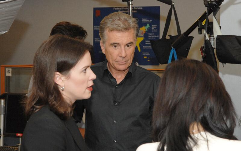Television personality John Walsh and former ICE Assistant Secretary Julie Myers Wood prepare for an interview.