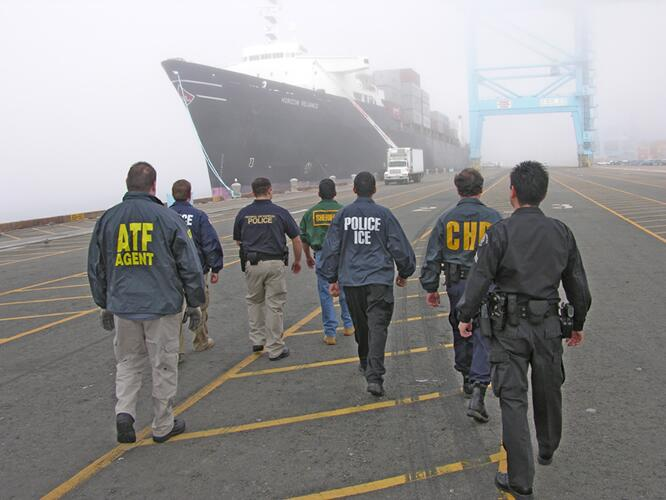 Border Enhancement Security Task Force officers approach a vessel.
