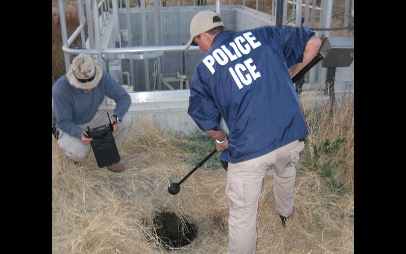 ICE officials conduct an investigation.