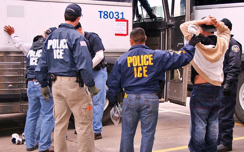 ICE officials make arrests during an operation targeting illicit transportation businesses.