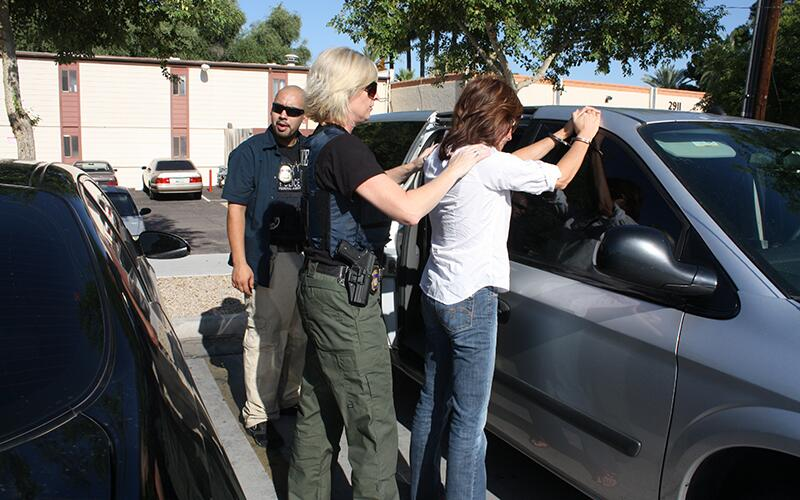 ICE officers arrest a criminal alien as part of Operation Cross Check.