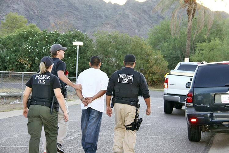ICE officials arrest a criminal alien during Operation Cross Check.