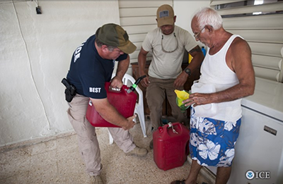 ICE Tampa personnel Nathan Cruz (center) and Paul Thompson (left) conduct welfare checks in Patillas and Yabucoa, Puerto Rico.