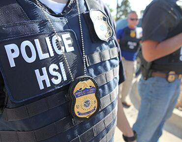 close up of an HSI Agents jacket and badge