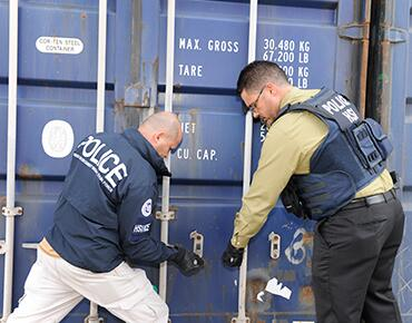 HSI Agents accessing a cargo box