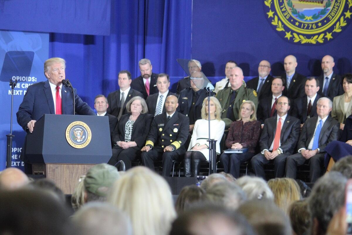 Federal, state, and local leadership including DHS Secretary Kirstjen Nielsen, U.S. Attorney General Jeff Sessions, New Hampshire Governor Chris Sununu, HSI-Boston Acting Special Agent In Charge Michael Shea and HSI New Hampshire Resident Agent In Charge Michael Posanka listen attentively as President Donald J. Trump outlines the administration's major ongoing efforts and commitment to combatting the opioid criss at Manchester Community College, Monday, March 19, 2018, Manchester, NH.
