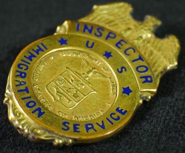 A historical immigration pin (picture provided by U.S. Citizenship and Immigration Services).