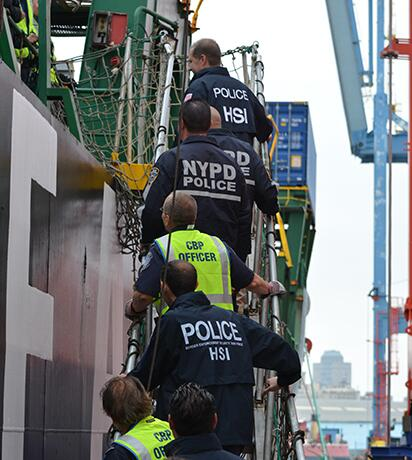 HSI Agents at a port with CBP Officers and the NYPD Police