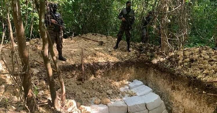 After offloading the cocaine, the narco traffickers attempted to bury the drugs.  Total- 2,107 kgs.
