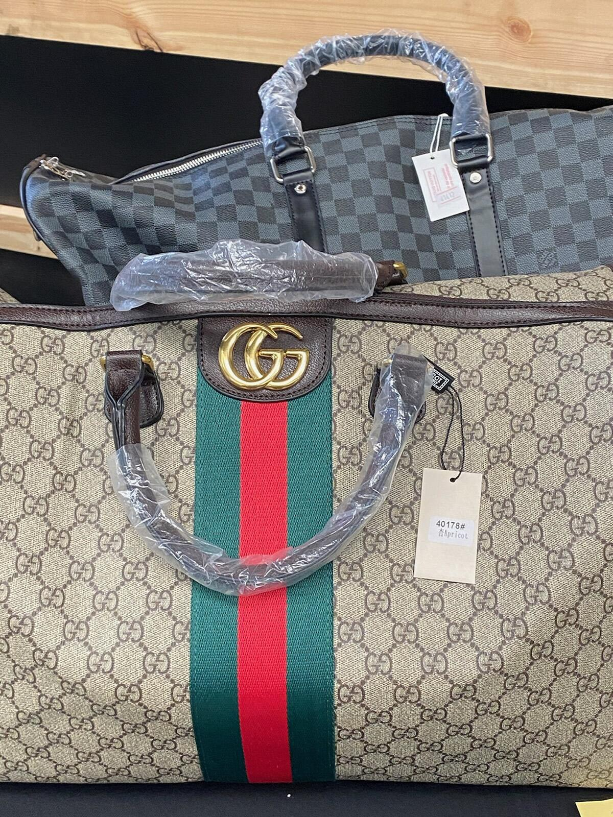 Over 1,000 items were confiscated, including several boxes of luxury designer goods such as high-end purses, caps, shoes and sunglasses.
