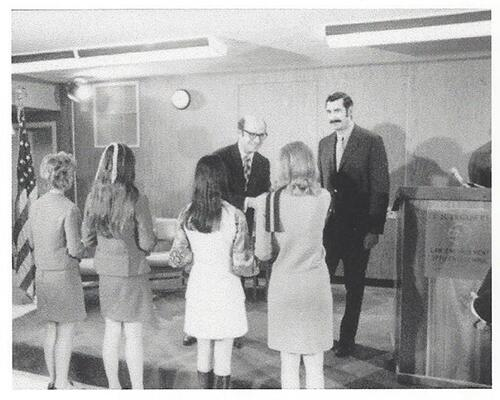 The first four female customs security officers receive congratulations from Treasury Secretary Eugene Rossides at a graduation ceremony in 1971 (picture provided by U.S. Customs and Border Protection).