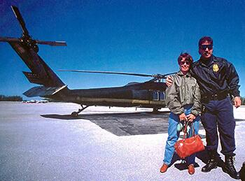 Agent Cannon returning to Homestead Airforce Base in a U.S. Customs Blackhawk with her go-bag. Agent Damon Ostis, right.