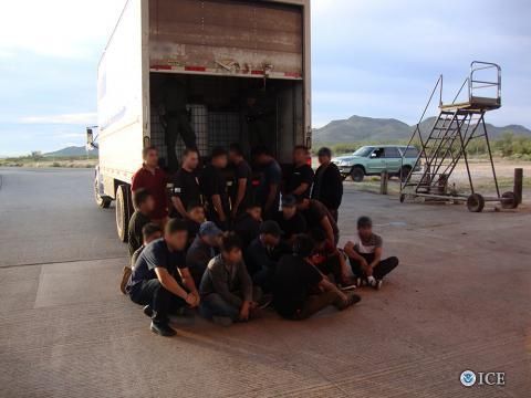 All of these illegal aliens were smuggled in the partial space of the truck not taken up by cargo.
