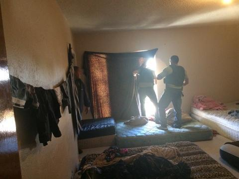 ICE HSI Task Force officers search the emptied rooms of a stash house on the southwest border.