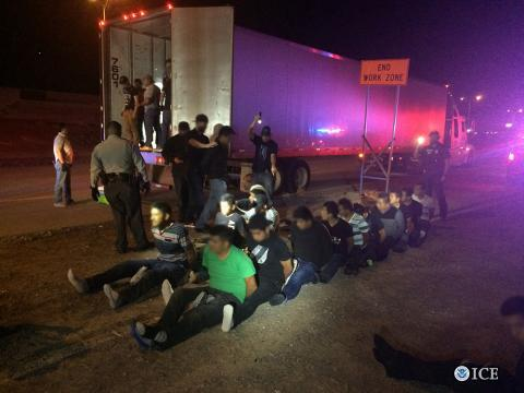 ICE HSI special agents detain illegal aliens.