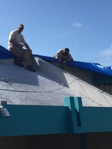 Special agents from the HSI Dallas Rapid Response Team (RRT) place a tarp on the roof of an orphanage in Arecibo, PR. Dallas RRT has been deployed for all three of the last major hurricanes.