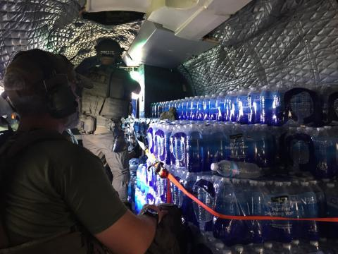 HSI special agents moving water and food via helicopter to more remote areas of Puerto Rico.