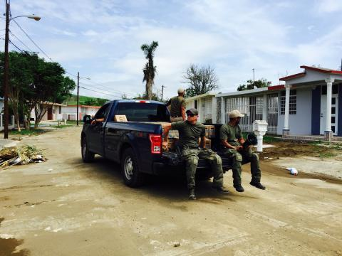 Special agents from HSI New York's Special Response Team drive street by street in Yauco, #PuertoRico seeking residents who may be in need food and water. River overflow from Hurricane Maria submersed this neighborhood in water.