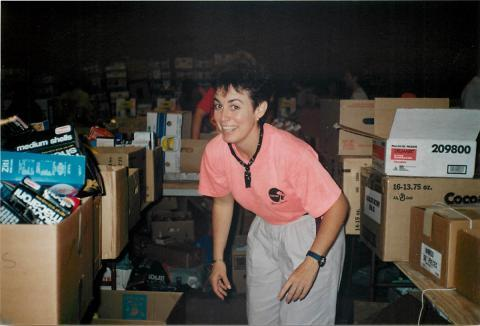 Cannon volunteers for Hurricane Andrew relief at a distribution warehouse west of Miami International Airport, 1992.