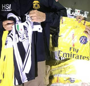 HSI Ho Chi Minh City, along with Vietnamese agents, display counterfeit goods that were destroyed in a mass operation on September 3, 2018.