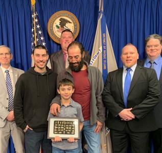 Present for the return ceremony :(Left to right) U.S. Attorney for Rhode Island Aaron L. Weisman, Wheeler family members, HSI Providence Special Agent Michael Polouski and HSI Tacoma (Washington) Special Agent Michael Roots; standing in rear : HSI Providence Resident Agent In Charge Bryan Lewis.