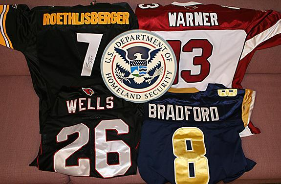 Four of the counterfeit NFL jerseys seized by ICE in Phoenix