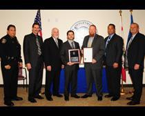 HSI representatives hold plaques of recognition presented Thursday by representatives from Daly City and South San Francisco. Pictured from left to right are: Daly City Police Chief Manuel Martinez; South San Francisco City Manager Barry Nagel; South San Francisco Mayor Richard Gabarino; HSI Special Agent in Charge Clark E. Settles; HSI Special Agent Anthony Tillett; HSI Acting Deputy Special Agent in Charge Raymond Greenlee; and South San Francisco Police Chief Michael Massoni