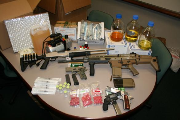 Chemicals, pills and weapons seized following discovery of suspected steroids lab