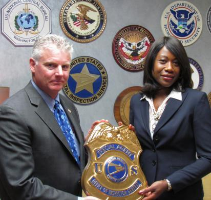 U. S. Postal Service Office of Inspector General becomes a partner of the National IPR Center. IPR Center Acting Director Bruce Foucart and USPSIC Deputy Assistant Inspector General Yvette Savoy.