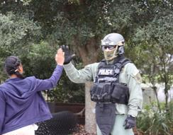 A special agent from U.S. Immigration and Customs Enforcement's (ICE) Homeland Security Investigations (HSI) Tampa Special Response Team gives a high five to a student during the Great American Teach In.