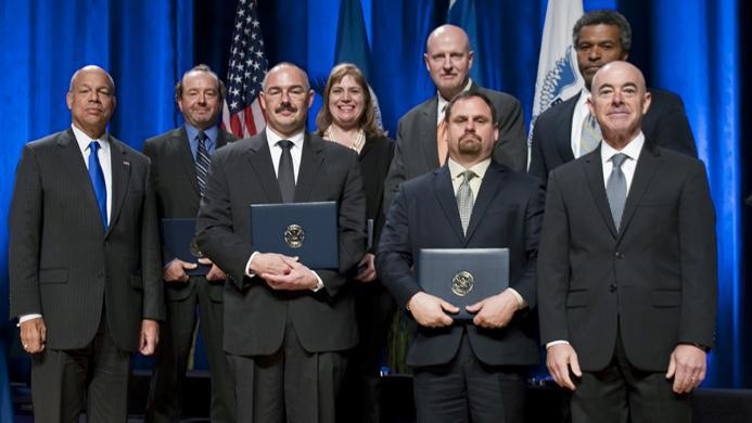 Secretary of Homeland Security Jeh Johnson and Deputy Secretary of Homeland Security Alejandro Mayorkas presented the Secretary's Customer Service Award to members of the U.S. Immigration and Customs Enforcement National Intellectual Property Rights Coordination Center - Report IP Theft Form