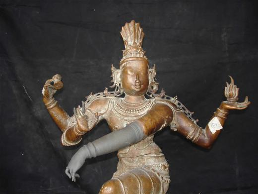 Shiva Nataraja arm being repaired
