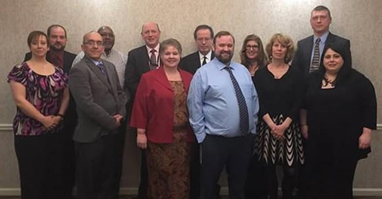 Pictured left to right is a subset of the full team's 36 staff members. First Row: Section Chief Staci Davis, Law Enforcement Specialists Richard Dane, Eleanor Allen, Adam Costa, Peggy LaForce, and Lauren Matthei; Second Row: Supervisory Law Enforcement Specialist Shawn Guilmette, Law Enforcement Specialists Bobby McKnight, Andrew Richardson, and Arne Harkonen, Director Linda Past, and Law Enforcement Specialist Shawn Murphy.