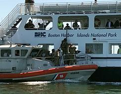 "HSI Boston Special Response Team (SRT) members onboard U.S. Coast Guard cutter move alongside ""cruise ship"" with suspected bomber aboard for maritime active shooter exercise in Boston Harbor."