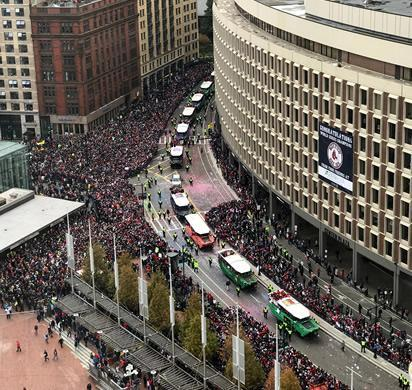 "Fans along the 2018 World Series Champions parade ""duck boat"" parade through Boston on October 31."