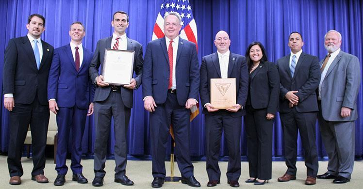 HSI personnel from Michigan and Ohio pose with James W. Carroll Jr., (center), the current director of the U.S. Office of National Drug Control Policy July 19, at the annual U.S. Interdiction Coordinator Award Ceremony.