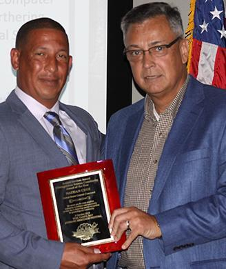 CFA Nathan Cruz receives his honor from retired Brig. Gen. Hector Pagan, with Course of Action, the organizing group of Viva Tampa Bay Hispanic Heritage Hero award program.