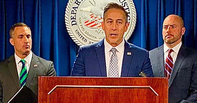 (Left to right:) Joseph R. Bonavolonta, Special Agent in Charge of the Federal Bureau of Investigation, Boston Field Division; HSI Boston acting Special Agent In Charge Jason J. Molina, and U.S. Attorney for Massachusetts Andrew E. Lelling announce results of investigation at U.S. federal court in Boston November 15.