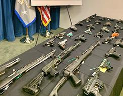 Illegal firearms seized as part of the joint local, state and federal investigation are displayed at the press conference announcing results of the investigation in Boston.
